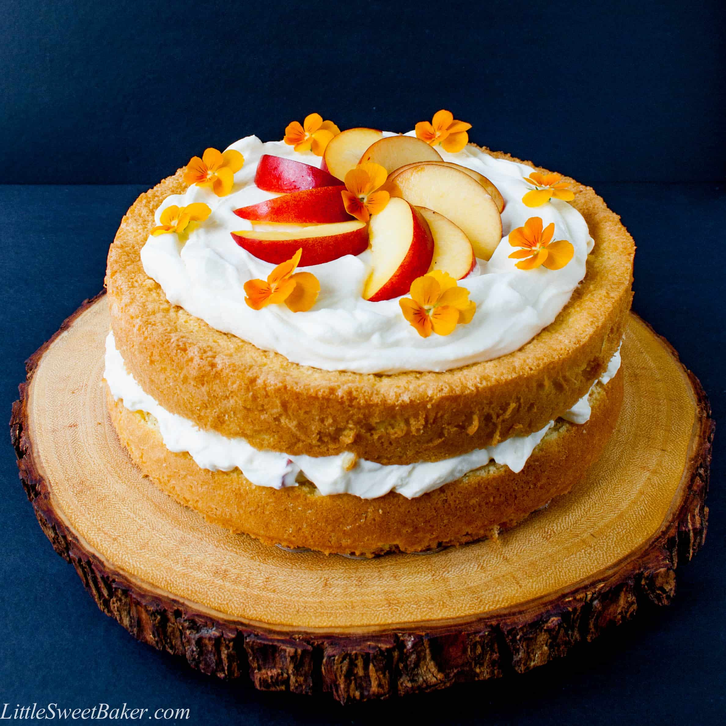 PEACHES AND CREAM CAKE. A simple 3-ingredient sponge cake with a fresh peaches and cream filling and finished with a cloud of whipped topping.