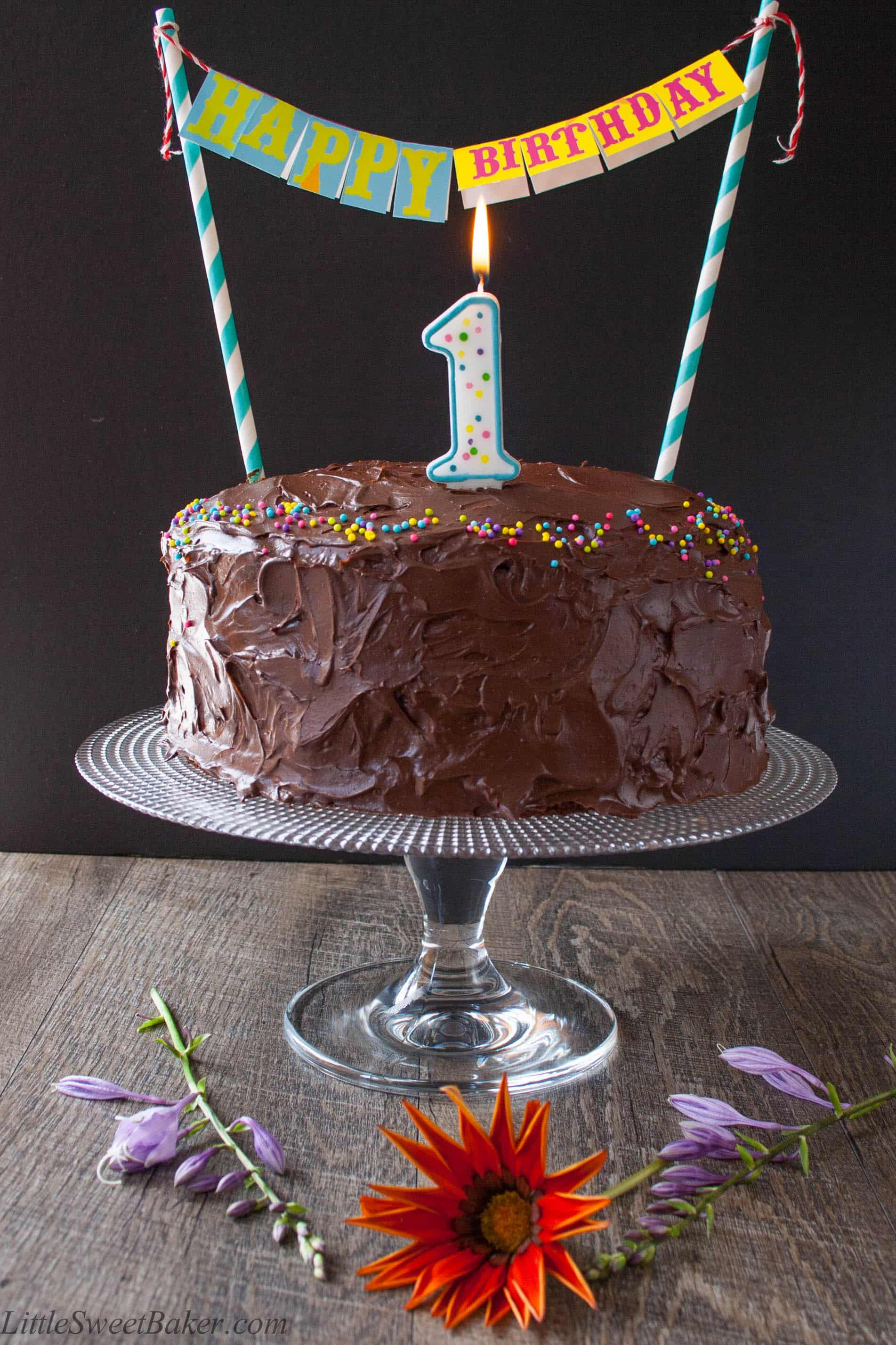 CHOCOLATE BIRTHDAY CAKE. A decadent 3-layer chocolate cake surrounded with the most luxurious rich chocolate frosting. Perfect for any occasion.